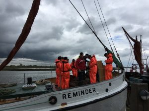 "Year 9 boys on the Bow of ""Reminder"" checking their life jackets in Maldon"